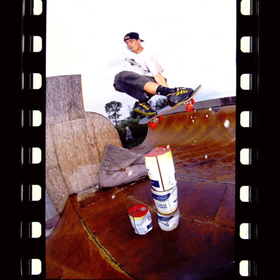 Even if I lie on my back with a board on my feet, I cannot make my body tweak like that, let alone in the middle of a f/s nosebone transfer over four cans of water sealer (irony?) stacked high on a weird gap in the middle of a wet vert ramp.  Photo: Morford</span>